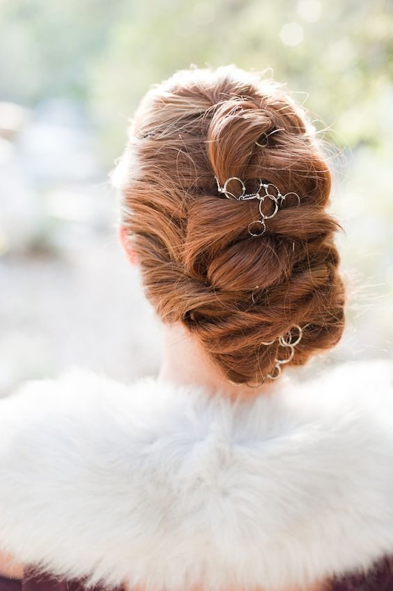 twisted updo hairstyle with hair jewlery