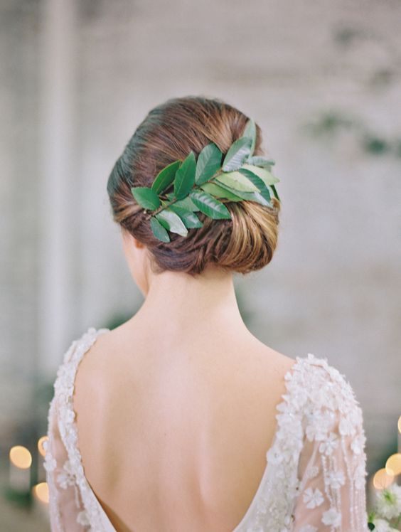 sleek low bun with greenery