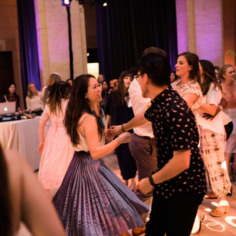 a couple dancing together at a wedding event