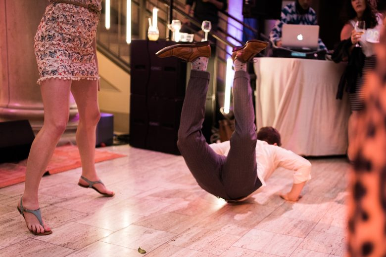 a man dancing on the floor of a wedding event