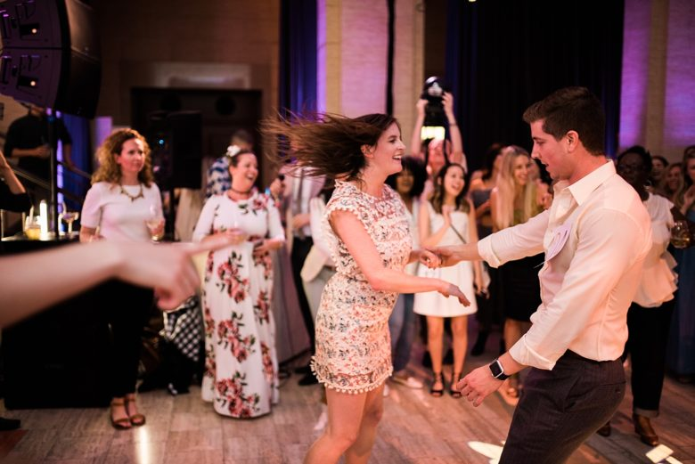 two people dancing at a wedding event