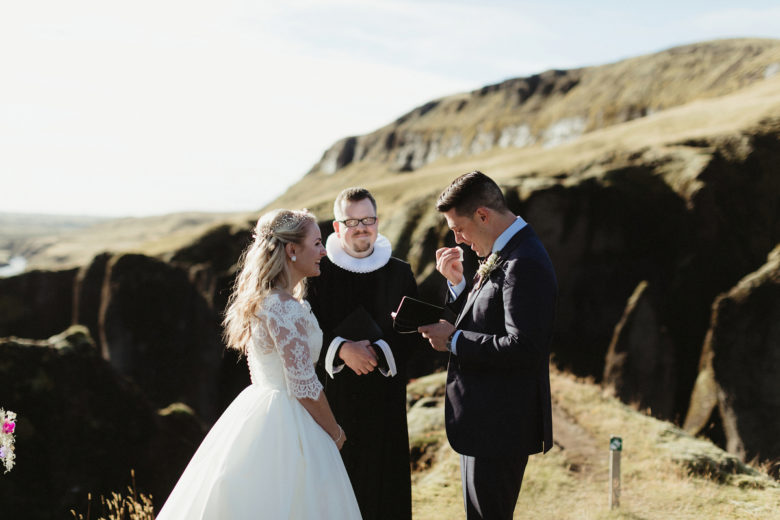 Bride, groom, and officient in Fjaðrárgljúfur