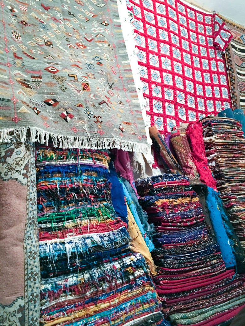 Piles of colorful moroccan carpets