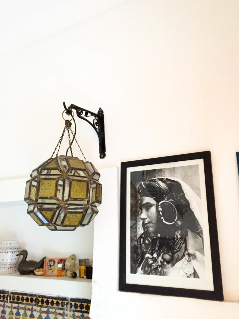 ornate lamp and image of a moroccan girl