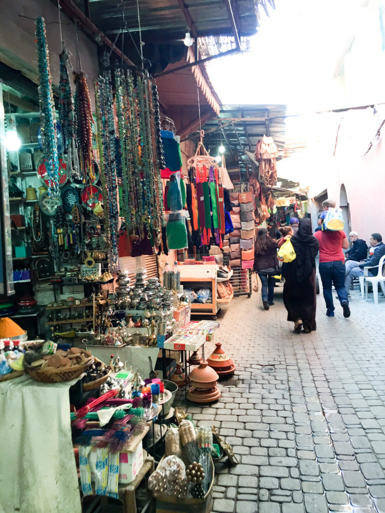 Scene from the sidewalk on a busy Marrakesh marketplace