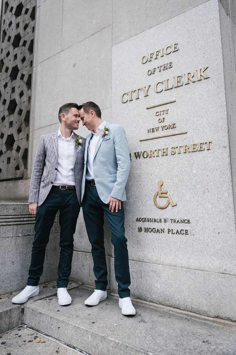 Two grooms outside of office of the city clerk, new york city hall