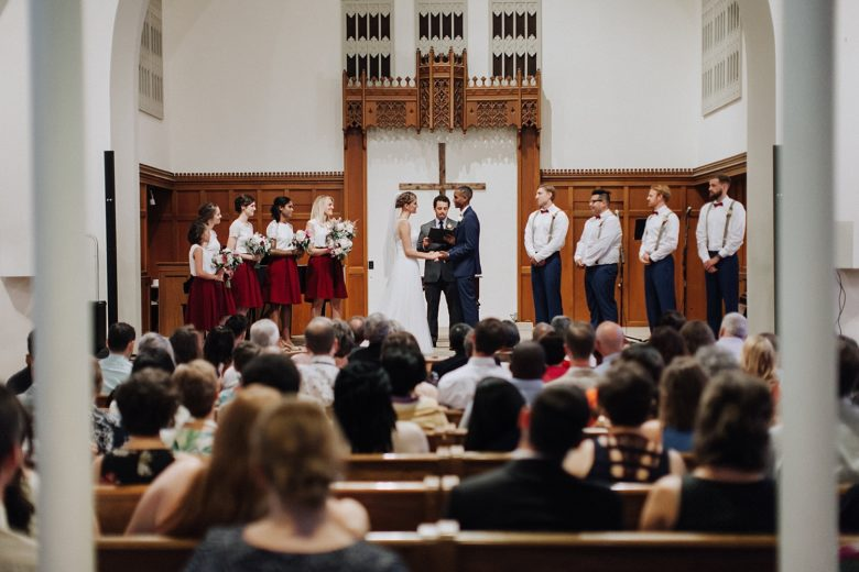 Wedding ceremony in church with bridesmaids and groomsmen