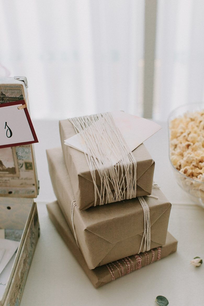 Brown paper packages tied up with string on the gift table