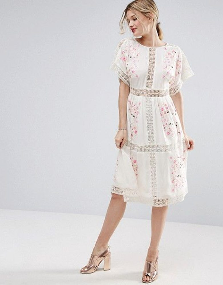 woman in white dress dress with crotchet lace stripes