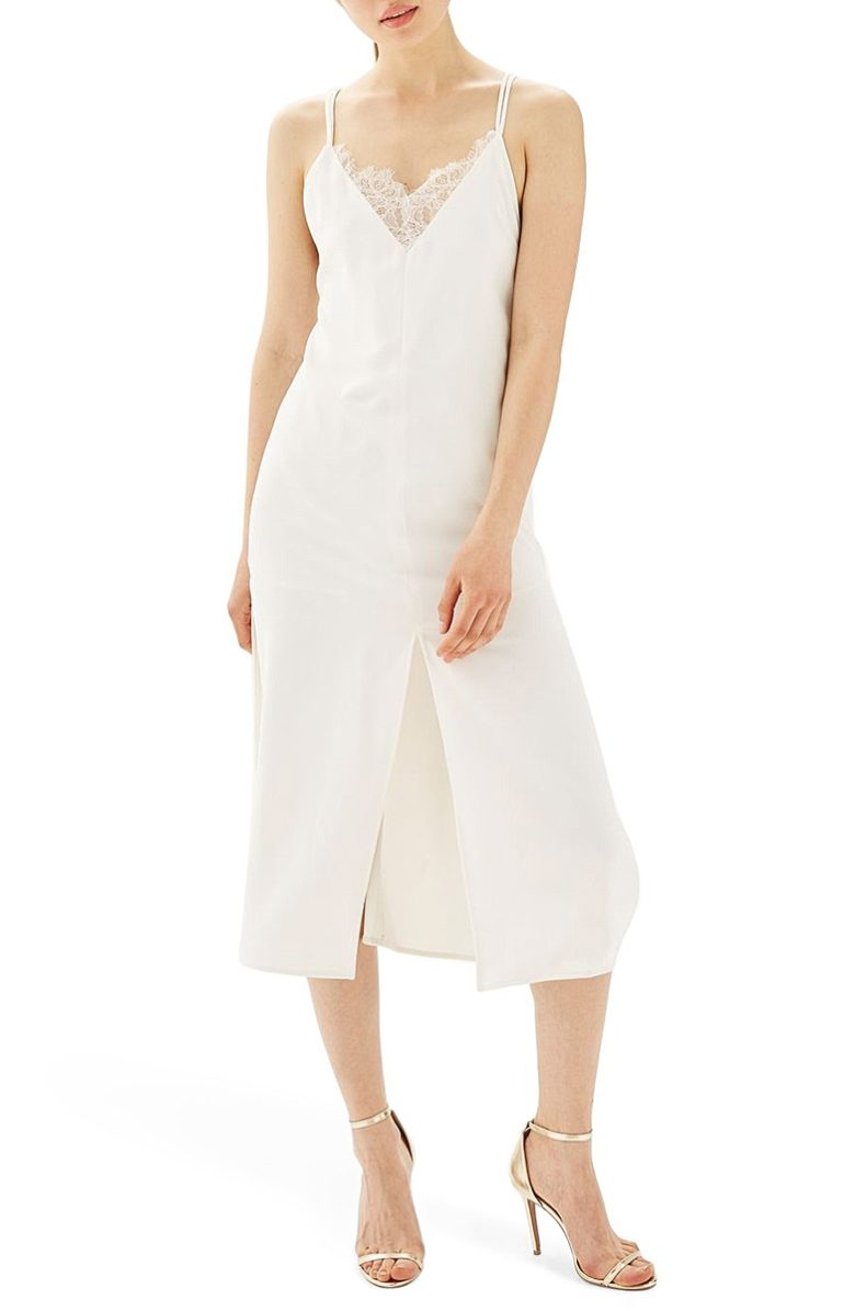 woman in white slip dress with lace neckline detail