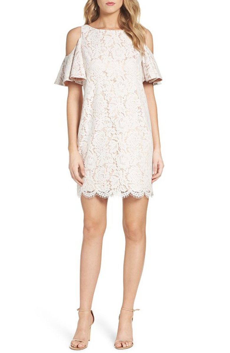 woman in cold shoulder lace mini-shift
