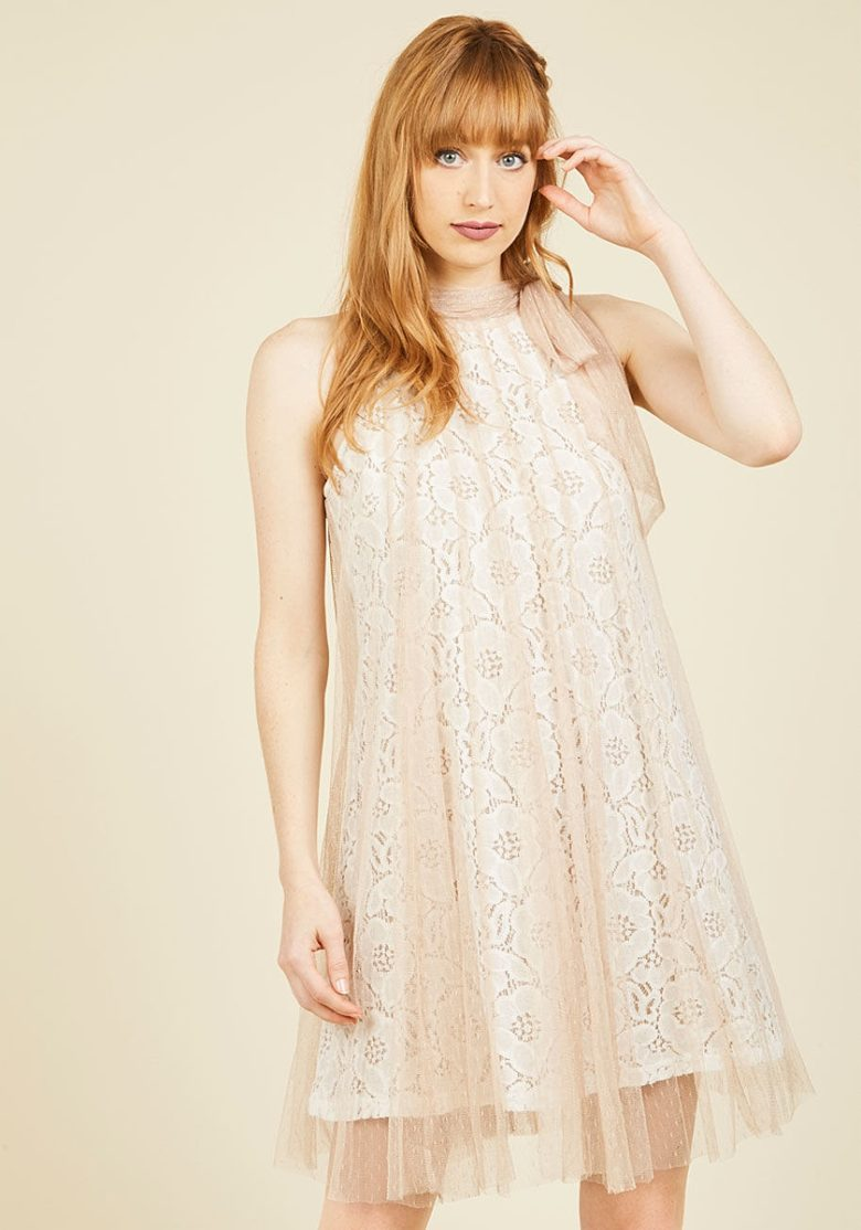 Lace shift high neck dress on redhead woman with tulle overlay
