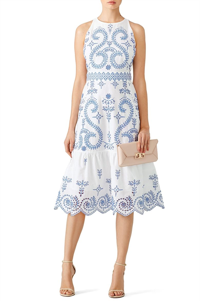 sleeveless fitted white dress with blue embroidery and ruffle bottom