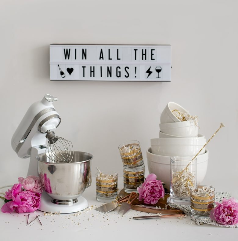 win all the things, full crate and barrel giveaway set, mini kitchenaid mixer, white prep and mixing bowls, cocktail pitcher and spoon, four gold striped old fashioned glasses, wooden cheese board, cheese knife set, napkins