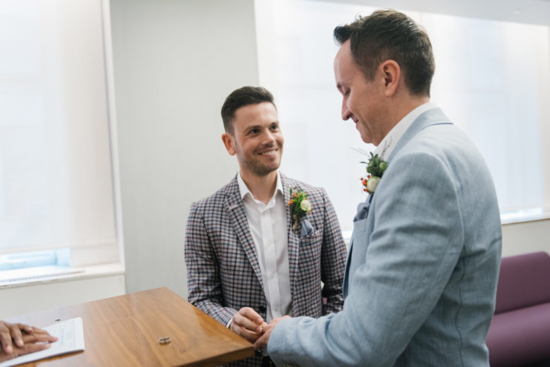 two grooms exchanging rings at New York City Hall