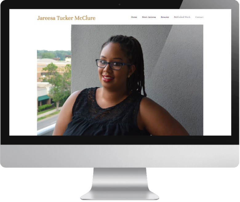 Jareesa Tucker McClure website on monitor
