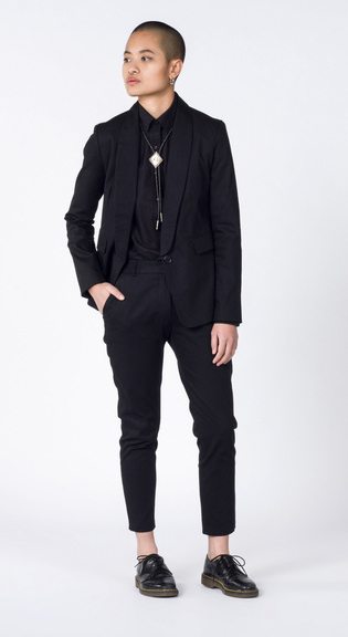 queer Masculine of center person in black suit
