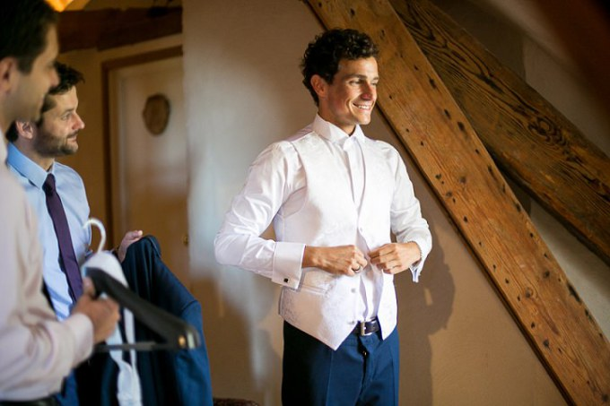 groom pack up his suits with a pleased smile
