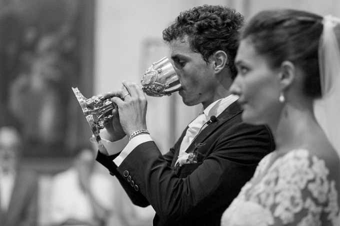 groom drinking weddign wine