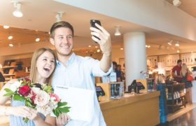 couple taking selfie at store